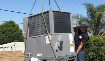 Mor Air employee installing an air conditioning unit outside in North Hollywood