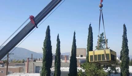 AC installation using a crane