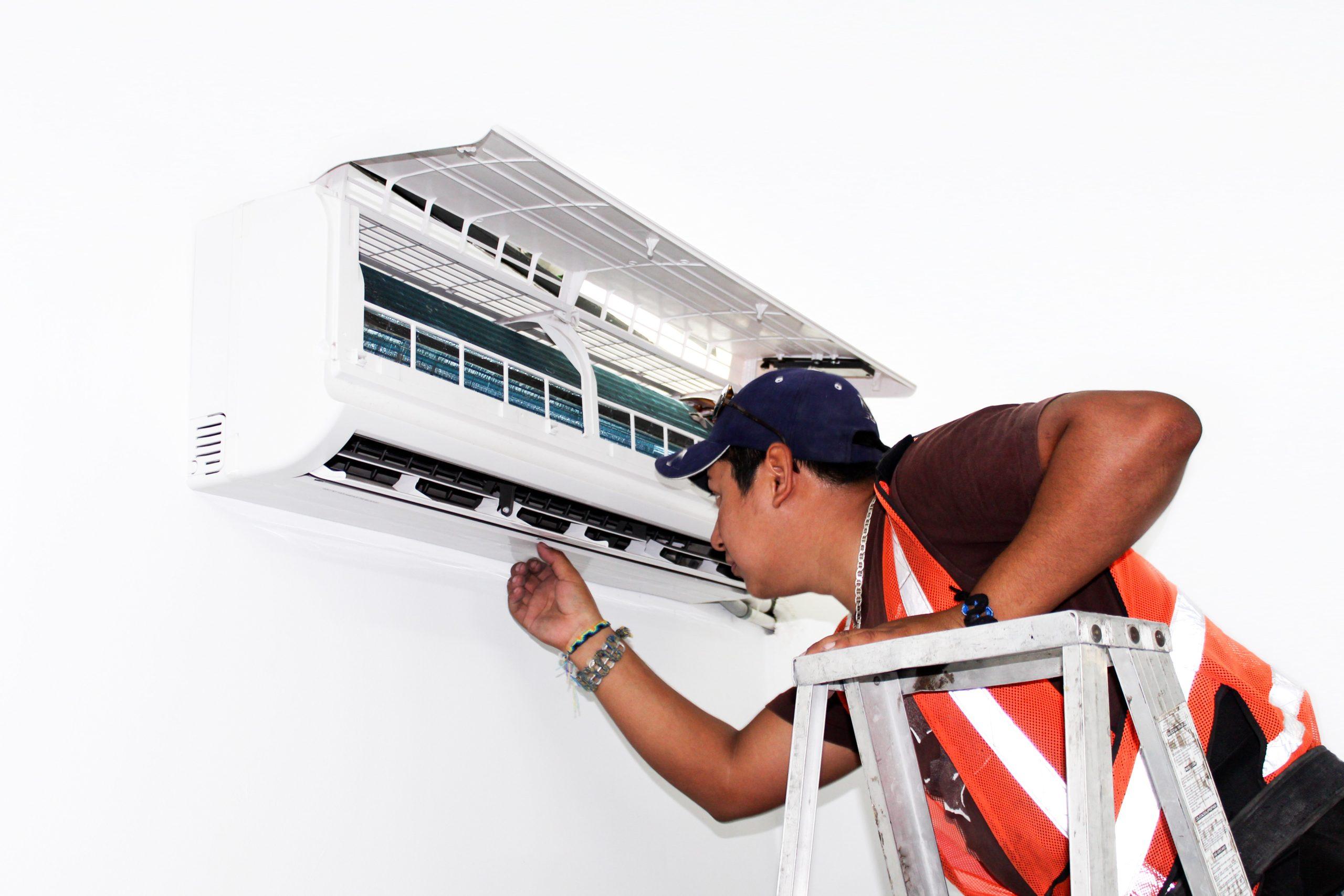 AC Repair expert looking at a unit in Los Angeles