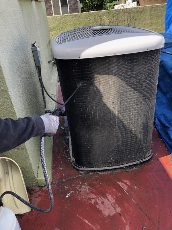 Our team cleansing an air condenser