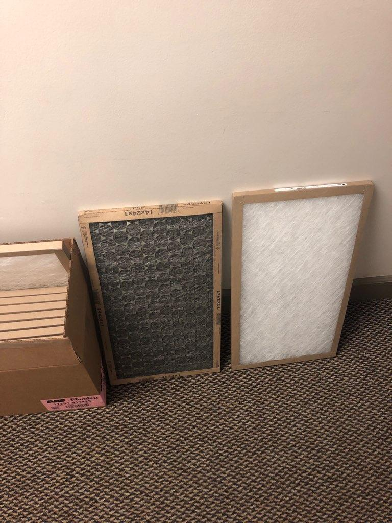 A row of of dirty and clean air filters